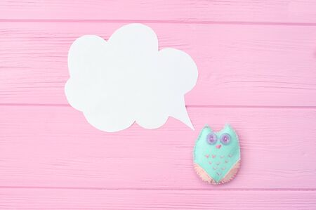 Toy owl with speech bubble. concept of time consuming on communication, with place for your text