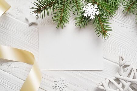 Christmas background for greeting card sheet of paper with place for text. xmas wooden background. Flat lay, top view photo mockup Stock Photo