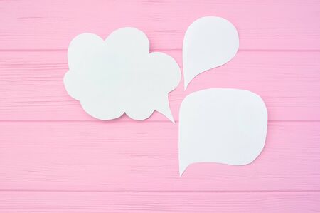 Collection paper speech bubble. Dialog questions and answer on a pink wooden background