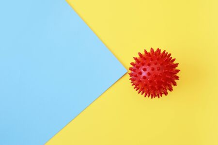 Abstract red ball virus strain model on yellow and blue background. Respiratory syndrome coronavirus and Novel coronavirus covid-19 with place for text background. Virus Pandemic Protection Concept
