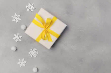 Christmas mock up background with snowflakes and gift boxes on wooden background with place for text. Colors of the year 2021 Ultimate Grey and Illuminating