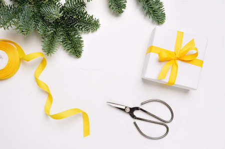 Christmas mock up banner background with snowflakes gift boxes and scissors on wooden background with place for text. Colors of the year 2021 yellow Illuminating Foto de archivo - 161618542