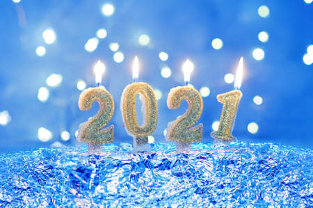Holiday background Happy New Year 2021. Numbers of year 2021 made by gold burning candles on bokeh festive sparkling background. celebrating New Year holiday, close-up. Space for text Foto de archivo - 161562086