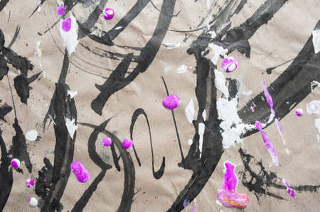 Black abstract brush strokes and splashes of paint on paper. Grunge art calligraphy background Foto de archivo - 162528733