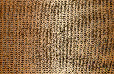 Distressed overlay texture of golden weaving fabric. grunge background.