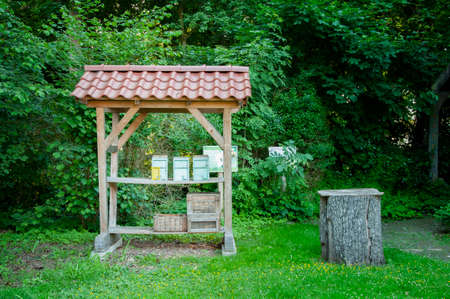BUNDE, GERMANY. JUNE 12, 2021. Beautiful view of small german town. Small advertizing alcove at the entrance of apiary
