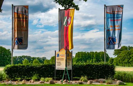 VERSMOLD, GERMANY. JUNE 20, 2021. Campingpark Sonnensee flags waving in the wind