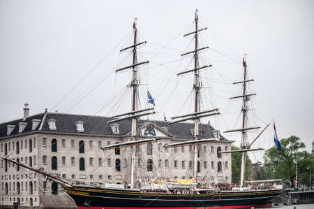 AMSTERDAM, NETHERLANDS. JUNE 06, 2021. Old wooden Stad Amsterdam ship. Black and white photography
