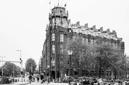 AMSTERDAM, NETHERLANDS. JUNE 06, 2021. Beautiful facade of Amrath Hotel. Black and white photography.