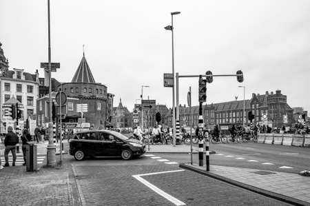 AMSTERDAM, NETHERLANDS. JUNE 06, 2021. Beautiful facades of the old dutch buildings. Black and white photography.
