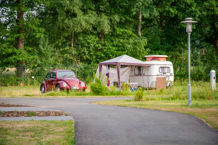VERSMOLD, GERMANY. JUNE 20, 2021 Campingpark Sonnensee. Tents, lodges people resting in the forest Редакционное