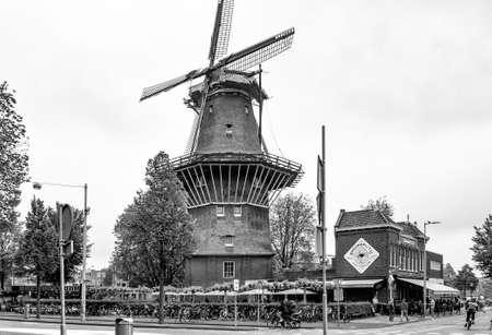 AMSTERDAM, NETHERLANDS. JUNE 06, 2021. De Gooyer windmill. The tallest wooden mill in the Netherlands. Black and white photography.