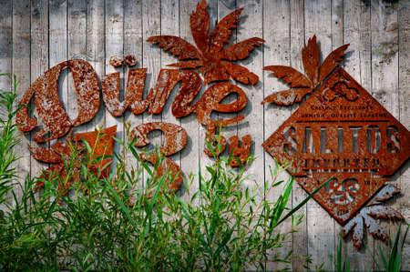 BIELEFELD, GERMANY. JUNE 20, 2021. Loheide park. Rusted Dune 13 signboard on the old wooden fence.