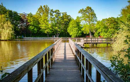BUNDE, GERMANY. MAY 31, 2021. Lake view Small bridge People walking around