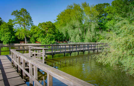 BUNDE, GERMANY. MAY 31, 2021 Lake view Small bridge