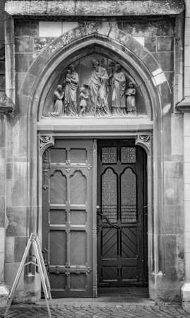 AACHEN, GERMANY. OCTOBER 04, 2020. The Town Hall Charlemagne Rathaus. Metalic wooden back door in ghotic style Фото со стока