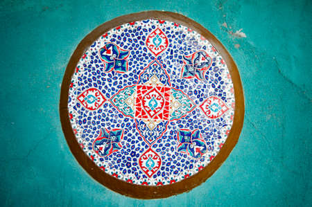 Turkish traditional ornament on the turquoise wall. Фото со стока