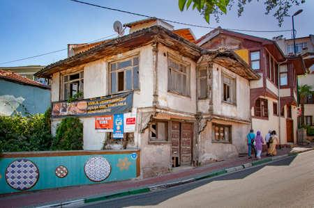 BURSA, TURKEY. AUGUST 15, 2021. Street view, old destroyed house Summer in the city