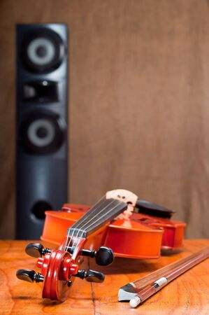 Musical concept with violin and hi-fi speaker photo