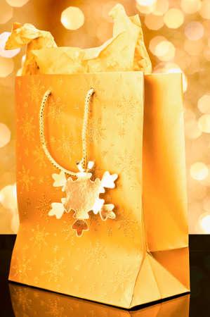 Golden gift bag on golden background photo