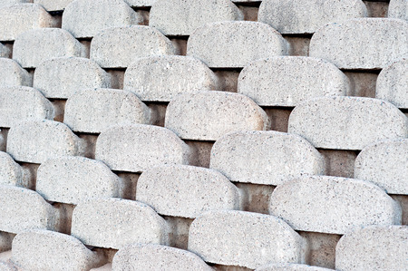 retaining: Close up patterns and textures of curved interlocking concrete retaining wall bricks