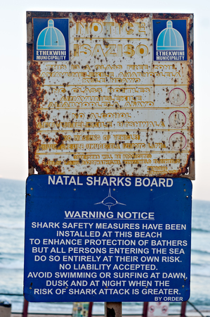 warning notice: DURBAN, SOUTH AFRICA - JULY 13, 2016: Ethekwini Municipality notice and Natal Sharks Board Warning Notice on the promenade at Umhlanga Rocks
