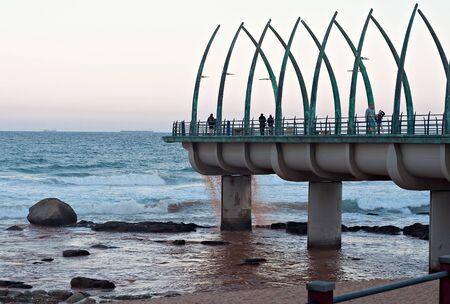 kwazulu natal: DURBAN, SOUTH AFRICA - JULY 11, 2016: People on the Millennium Pier at the beach in Umhlanga Rocks