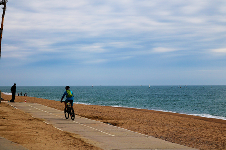 Cycling along the beach in Spain