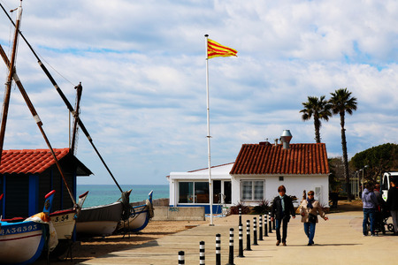 Beach house in Spain with spanish couple walking along beach coast Stock Photo - 99590828