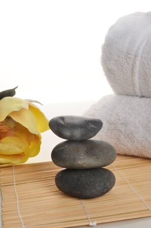 stones with flower: Holistic Stones Flower and Towel Stock Photo