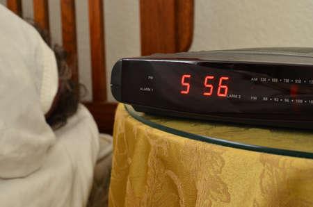 Early Morning wake up with alarm clock Stock Photo