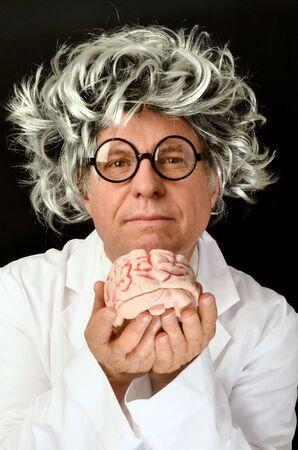 scientist man: Scientist holding a  Brain