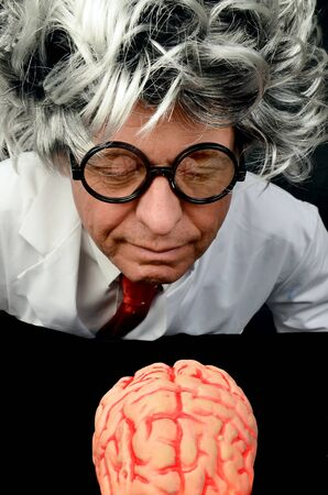 Scientist holding a  Brain photo