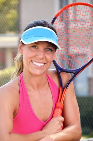 mid afternoon: Woman enjoying mid afternoon tennis  Stock Photo