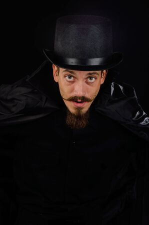 Evil Villain with top hat and cape Stock Photo - 16131372