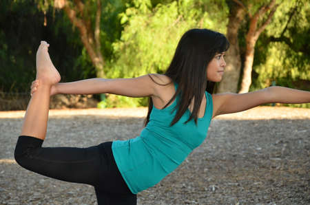Asian woman doing yoga in the Park