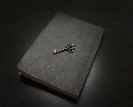 Book with key to illustrate wisdom and knowledhe
