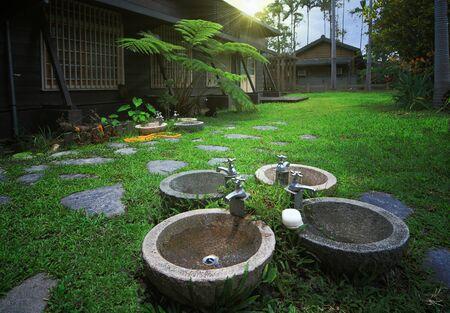 Washbasins in the backyard of Japanese wooden house photo