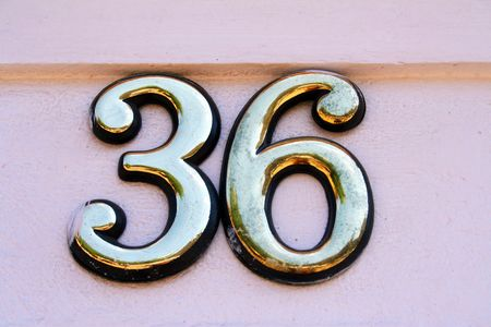 House address plate number 36 Stock Photo