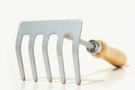 laborious: Hand rake against white background