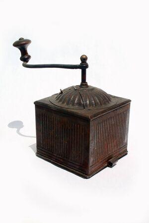 Antique spice grinder against white background photo