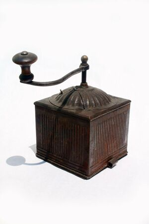 Antique spice grinder against white background