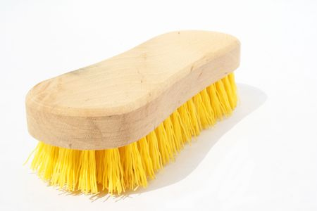 bristles: Scrub brush with polyester yellow bristles and wood handle against white background Stock Photo