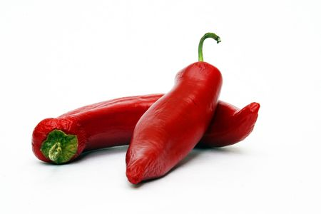 Two red chili peppers on white background Stock Photo