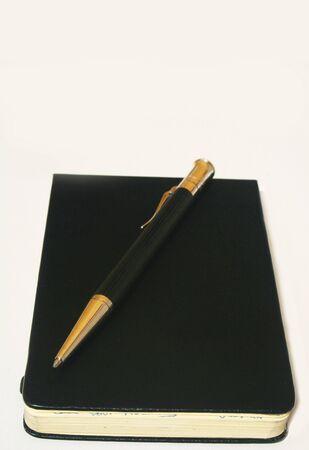 Ballpoint pen on rectangular leather notepad photo