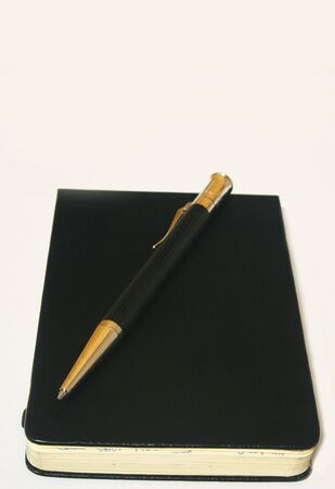 Ballpoint pen on rectangular leather notepad Stock Photo