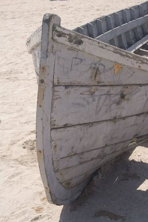 cloudless: Abandoned fishing boat on sand