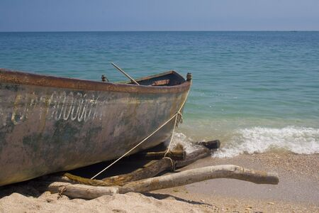 beached: Old fishing vessel beached on sand Stock Photo