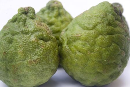 Kaffir limes isolated against a white background