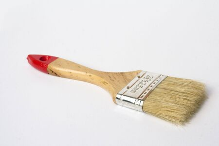 handled: A small wooden handled paint brush isolated against a white background Stock Photo